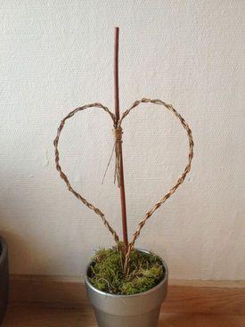 Hjerte lavet i pil sat i en urtepotte
